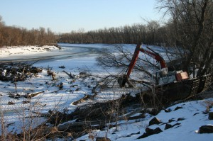 The Duck clearing logs on the bank of the Minnesota River